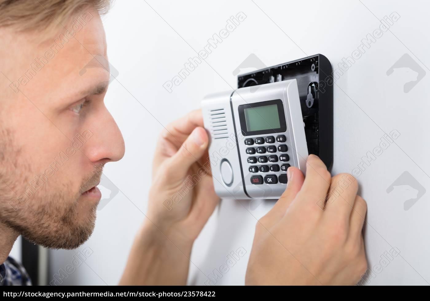 repairman, installing, security, system - 23578422