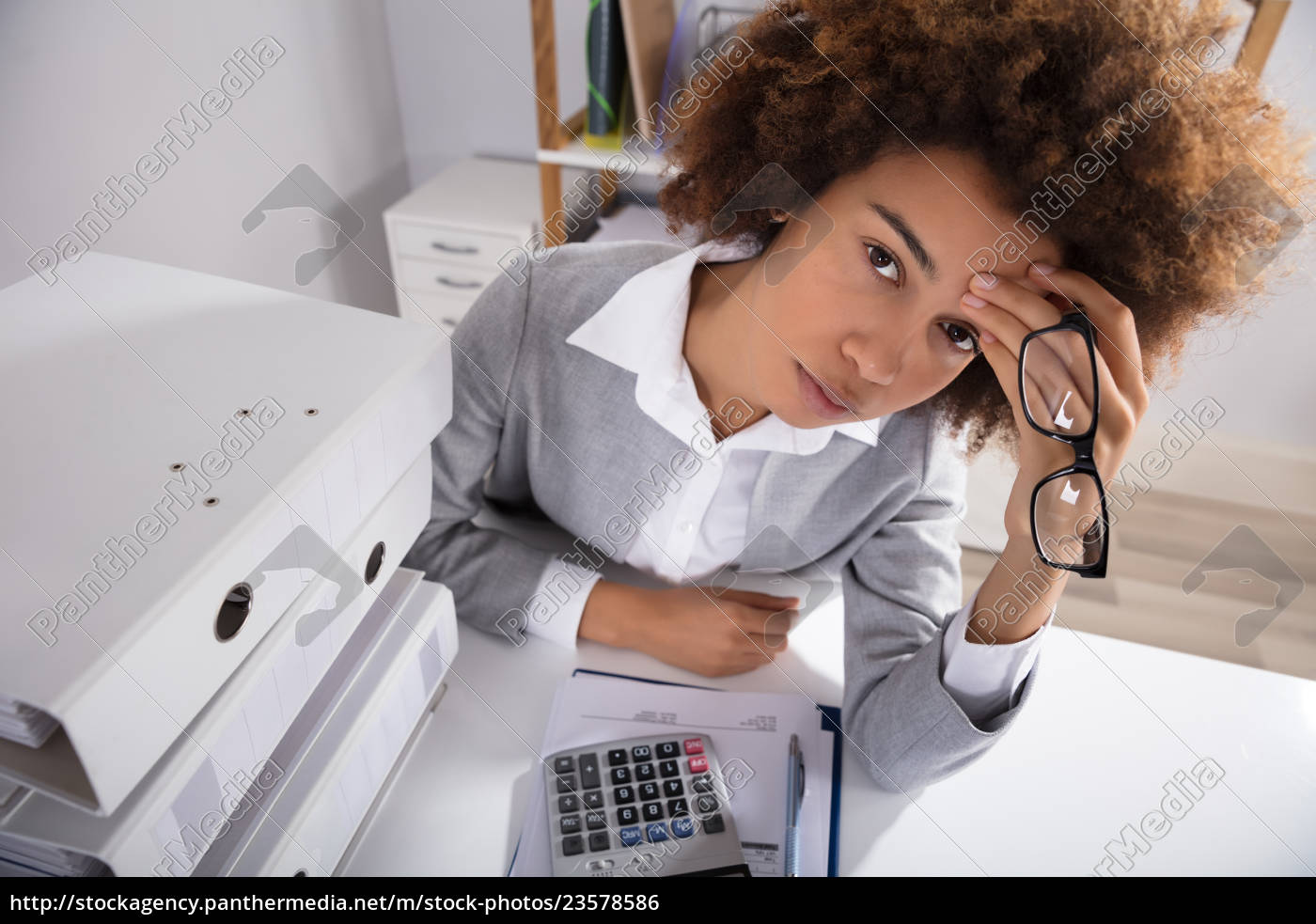 tired, businesswoman, sitting, in, office, with - 23578586