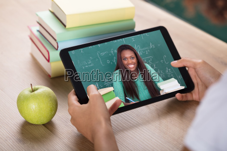 video, conferencing, with, female, teacher, on - 23578384