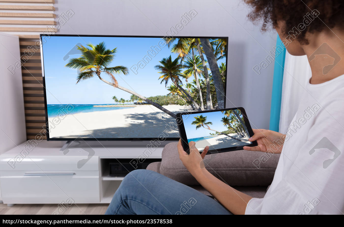 woman, connecting, tv, through, wi-fi, on - 23578538