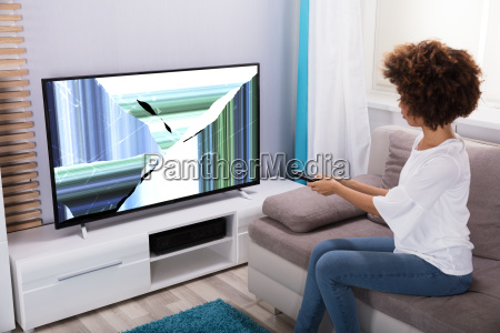 woman, sitting, near, television, showing, distorted - 23578546