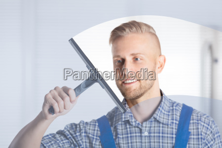 worker, cleaning, glass, window, with, squeegee - 23578428