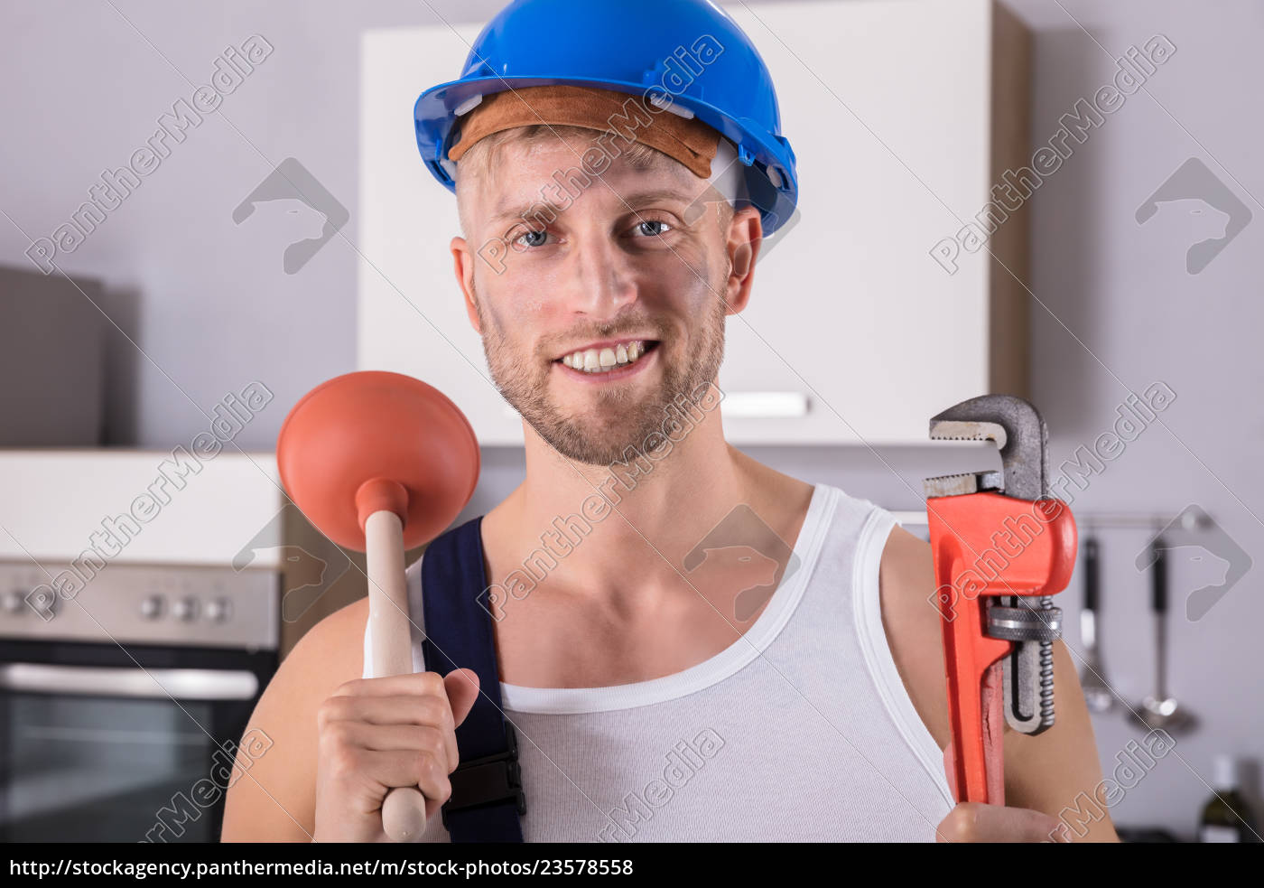 young, plumber, holding, wrench, and, plunger - 23578558