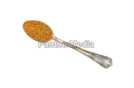vintage metal spoon full of brown