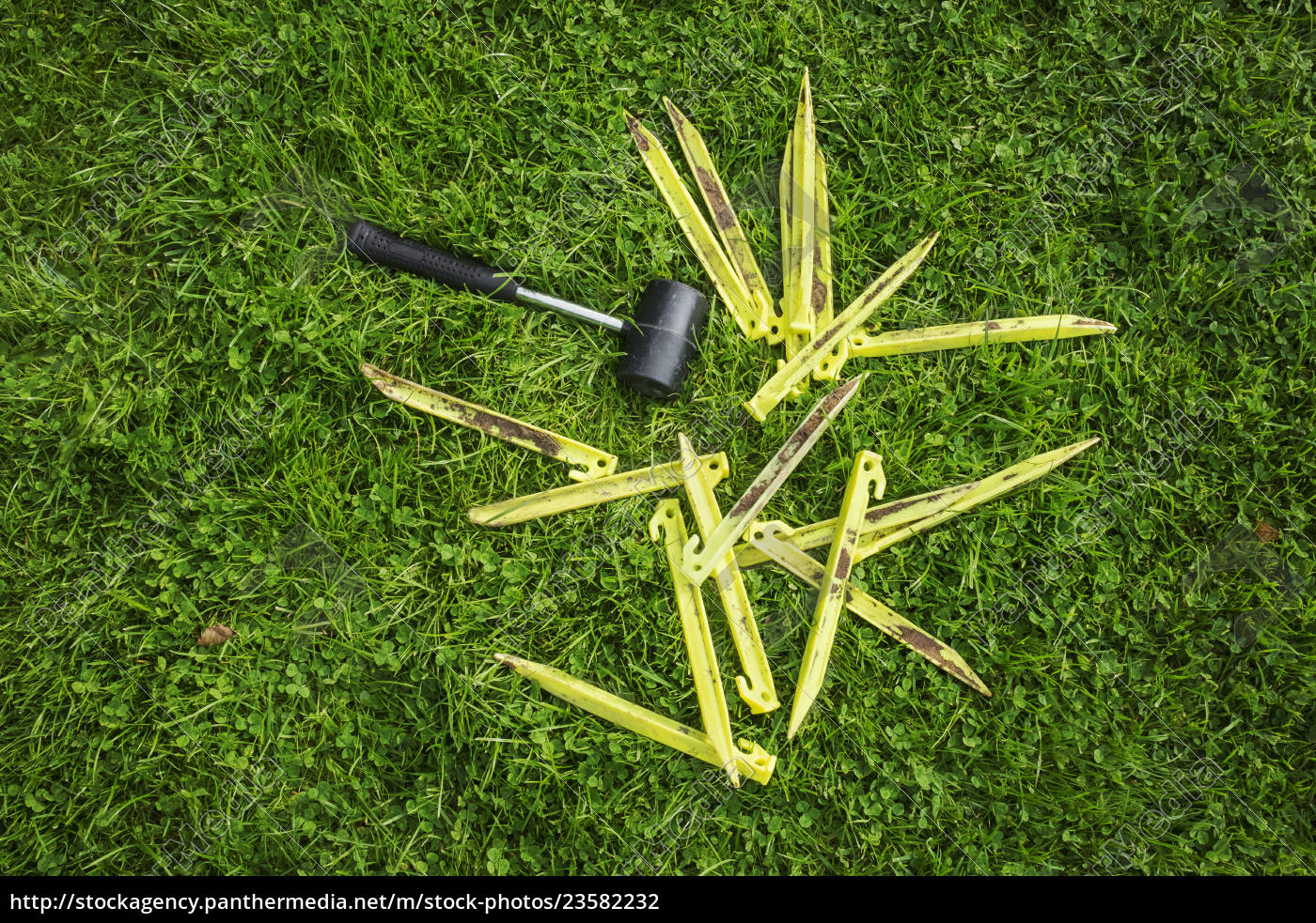 a, mallet, and, yellow, plastic, pegs, - 23582232