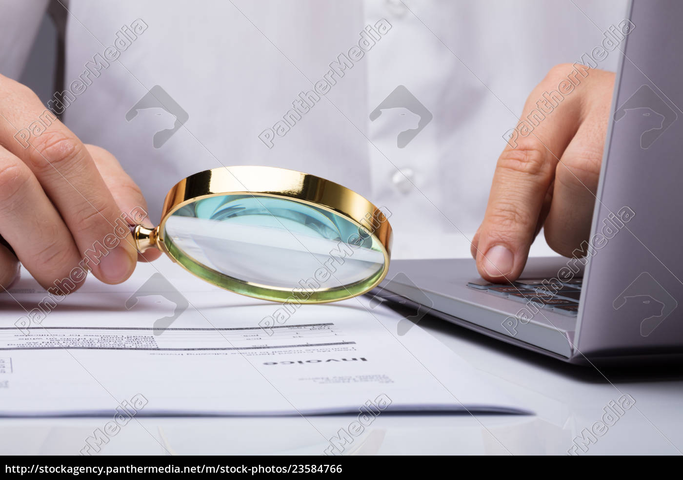 businessman, examining, invoice, with, magnifying, glass - 23584766