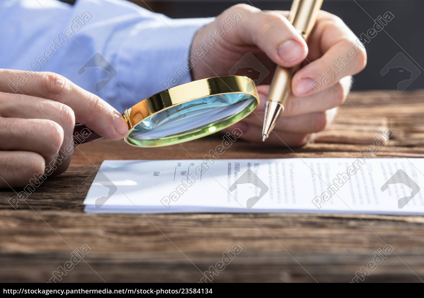 businessperson, looking, at, document, through, magnifying - 23584134