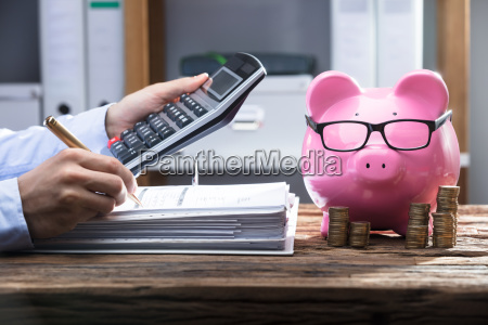 businessperson's, hand, calculating, bill - 23584880
