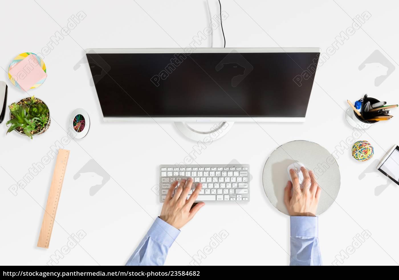 businessperson's, hand, working, on, computer - 23584682