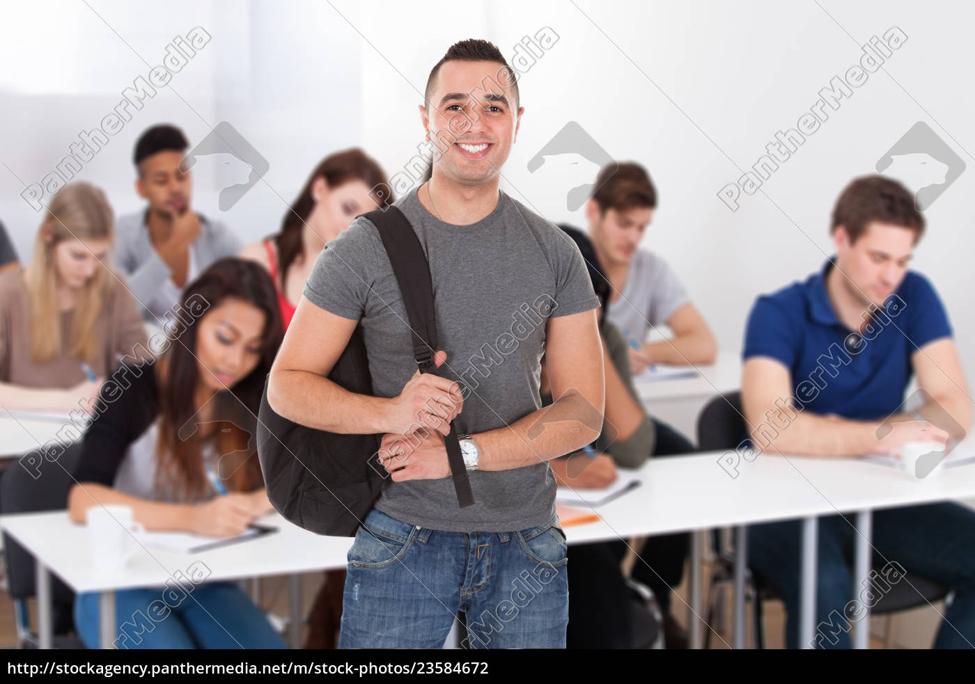 confident, male, student, carrying, backpack - 23584672