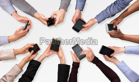 group, of, businesspeople, using, smartphone - 23584678