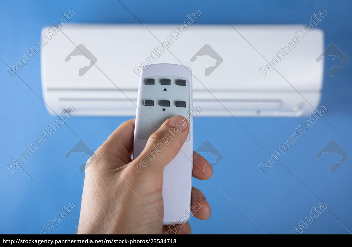 hand, adjusting, temperature, of, air, conditioner - 23584718