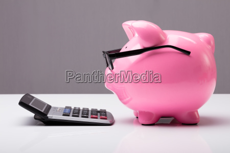 piggybank, with, eyeglasses, and, calculator - 23584758