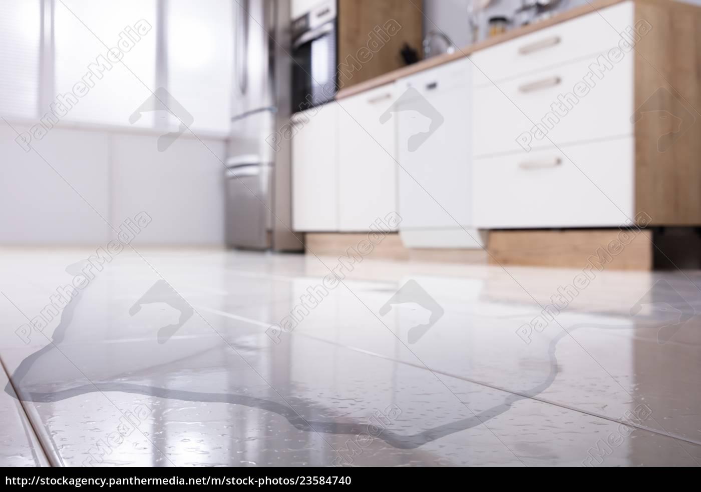 spilled, water, on, kitchen, floor - 23584740