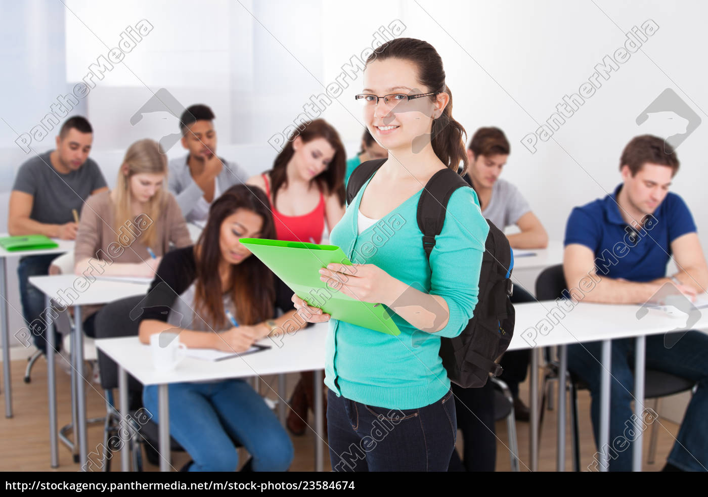 student, holding, file, against, white, background - 23584674