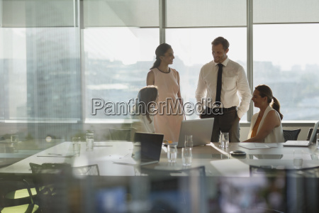 business people talking at laptop in