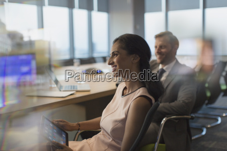 smiling businesswoman with digital tablet in