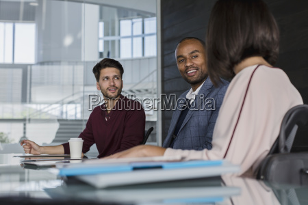 smiling business people talking planning in