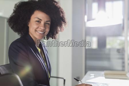 portrait smiling confident businesswoman working in