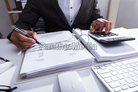 close up of a businessperson calculating