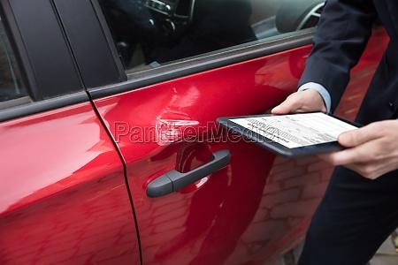 human hand holding digital tablet near
