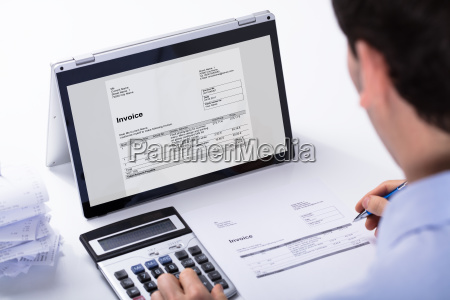 businessman calculating the invoice
