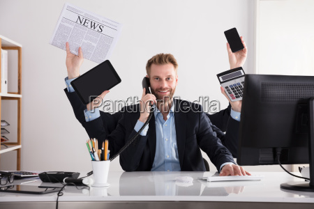 businessman, multitasking, in, office - 23595808