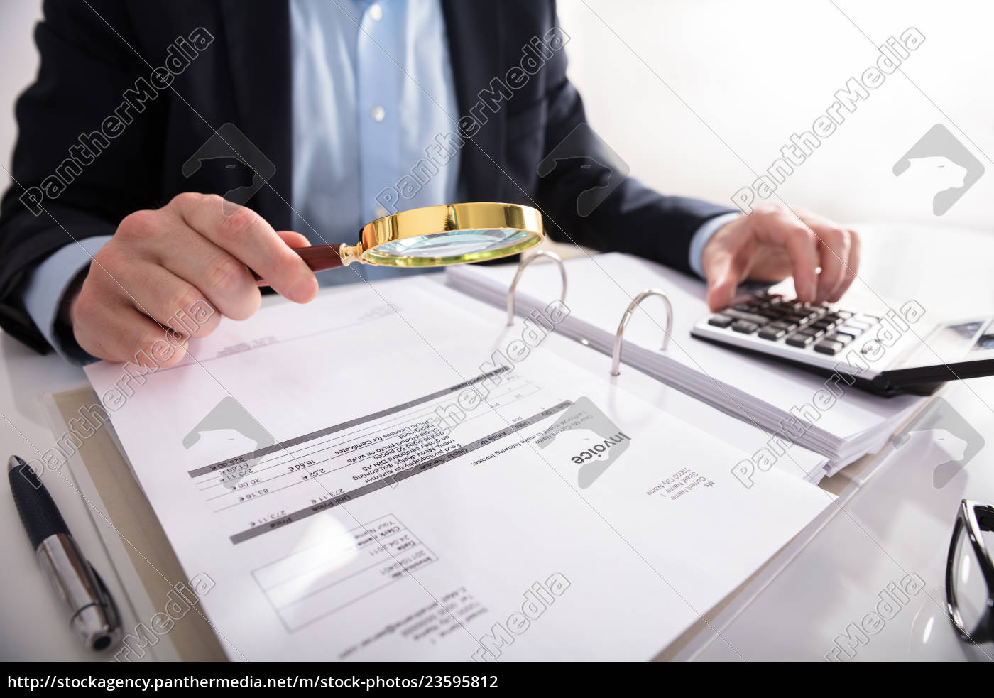 businessperson, checking, invoice, through, magnifying, glass - 23595812