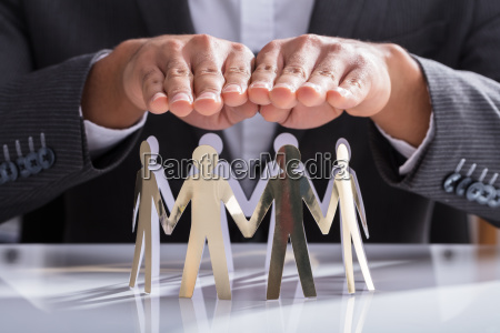 businessperson, protecting, cut-out, figures - 23595222