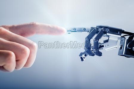 businessperson's, finger, touching, robotic, finger - 23595598