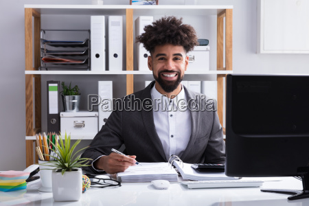 happy, businessman, working, in, office - 23595208