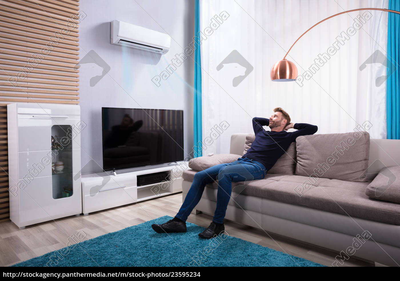 young, man, relaxing, on, sofa - 23595234