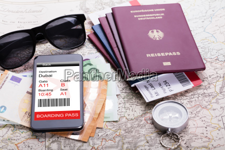 passport and currency notes on map