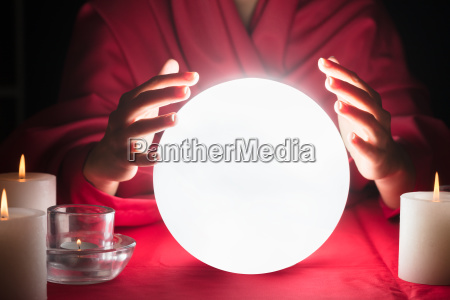 fortuneteller, holding, hands, around, a, glowing - 23596974