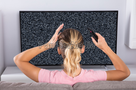 woman frustrated with a tv screen