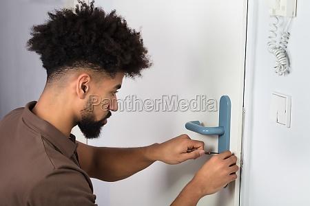 person opening door lock