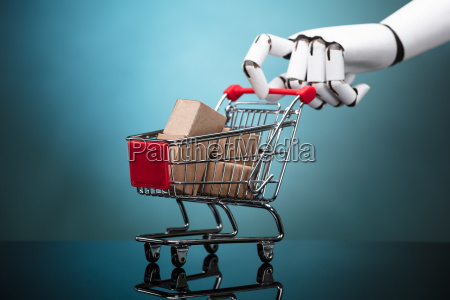 robot holding shopping cart with cardboard
