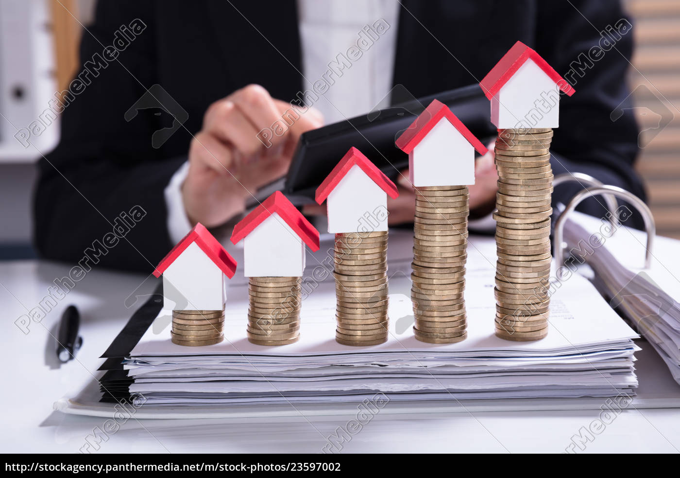 businesswoman, calculating, invoice, with, house, models - 23597002