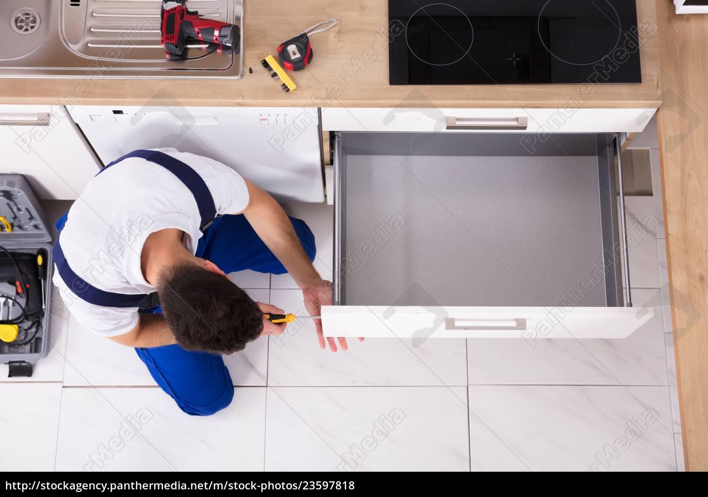 carpenter, fixing, drawer, in, kitchen - 23597818