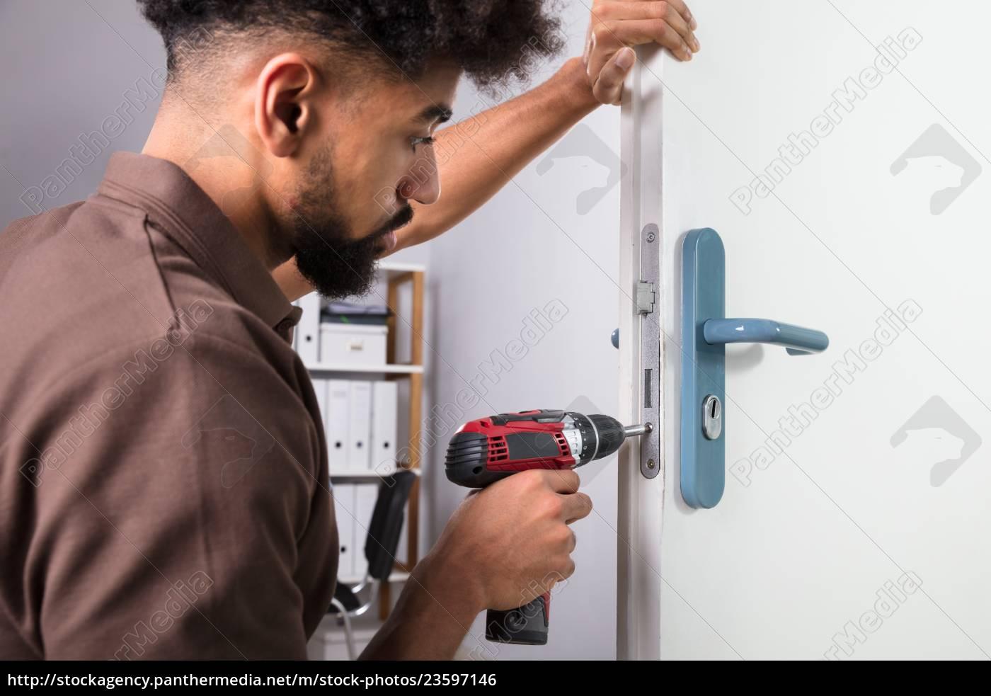 carpenter, installing, door, lock, with, wireless - 23597146