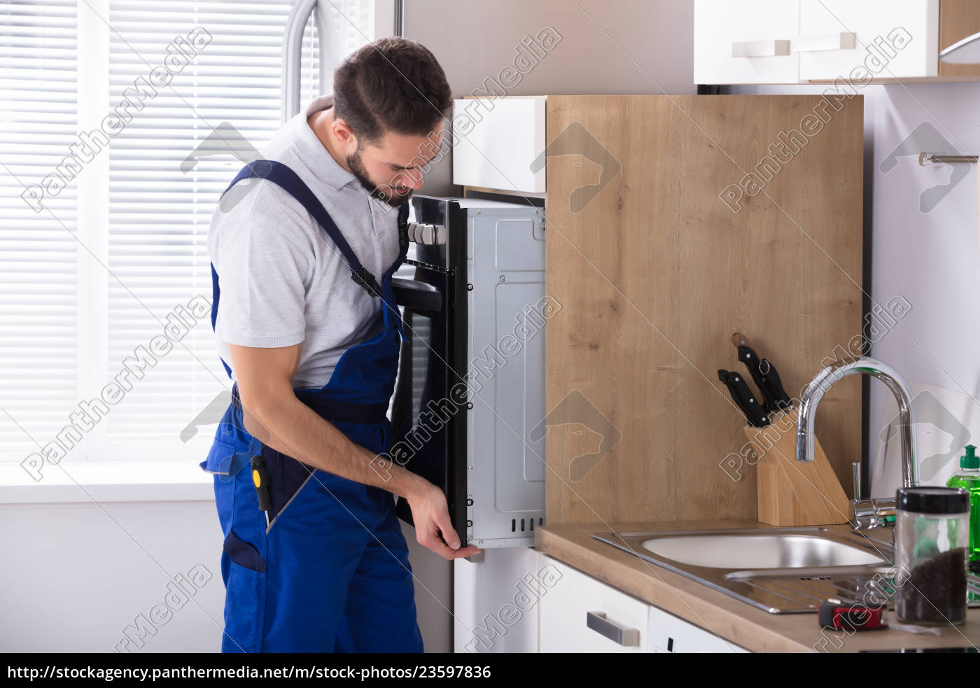male, electrician, fixing, oven - 23597836