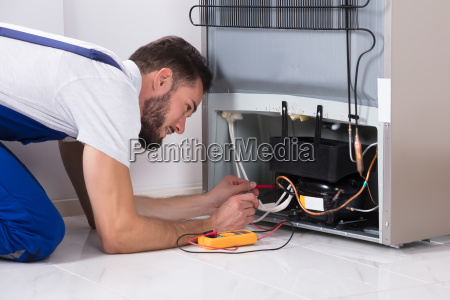 male, technician, examining, refrigerator - 23597840