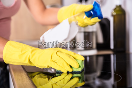 person, hands, cleaning, induction, stove, in - 23597108