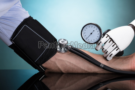 robot, checking, person's, blood, pressure - 23597928