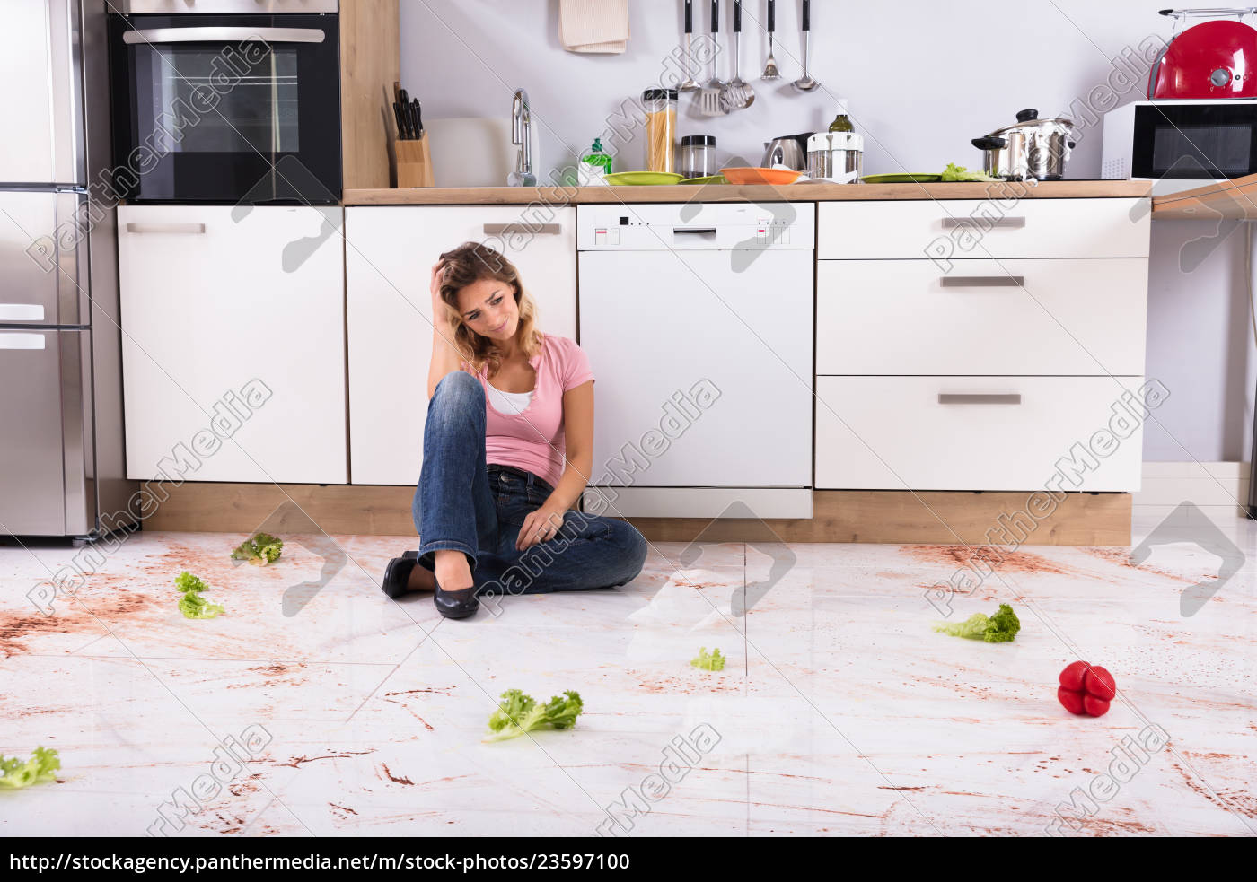 woman, sitting, on, messy, kitchen, floor - 23597100