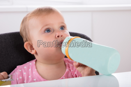 baby, girl, drinking, water, from, bottle - 23599880