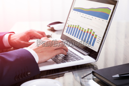 businessperson, analyzing, graph, on, laptop - 23599830