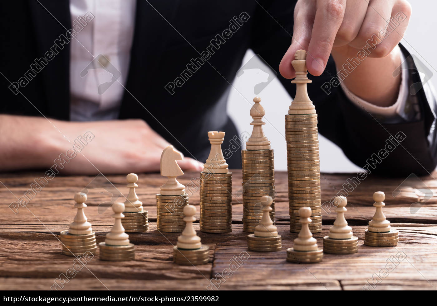 businessperson, arranging, chess, piece, on, stacked - 23599982