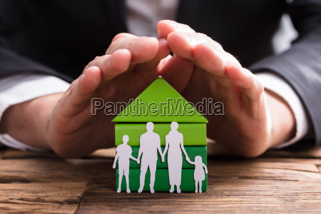 businessperson, protecting, house, model, and, family - 23599972