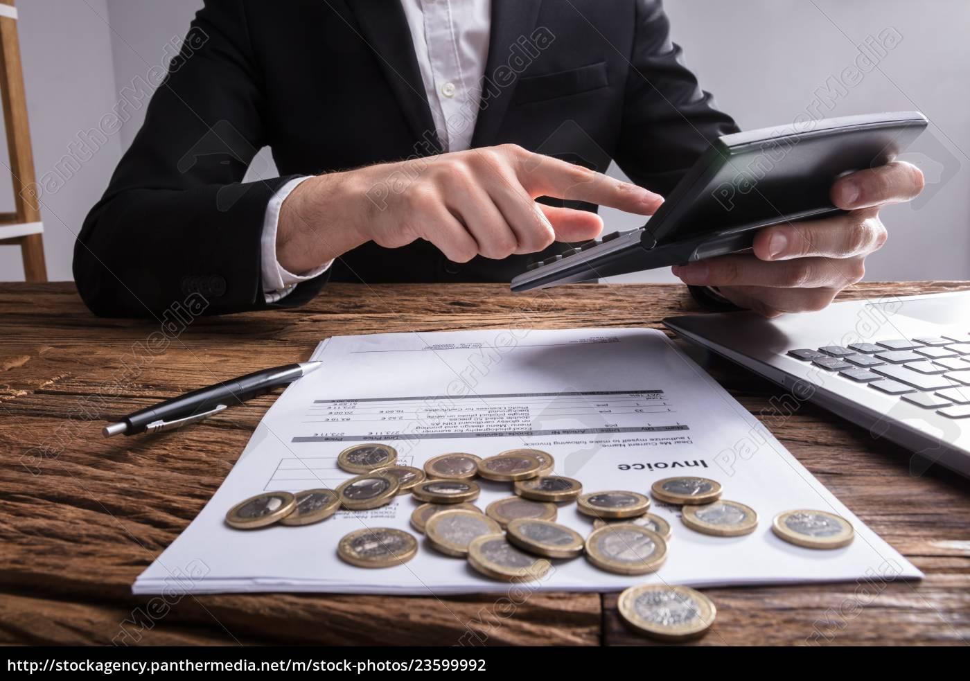 businessperson's, hand, analyzing, bill, with, calculator - 23599992
